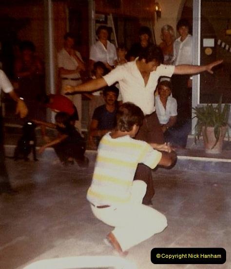 1980 Retrospective Corfu. (16) Out hotel waiters entertain us. 16