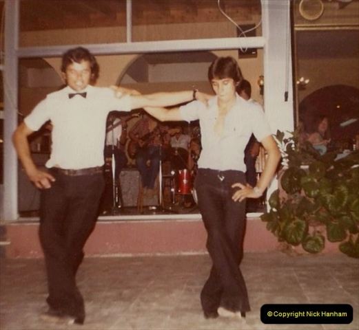 1980 Retrospective Corfu. (15) Out hotel waiters entertain us. 15