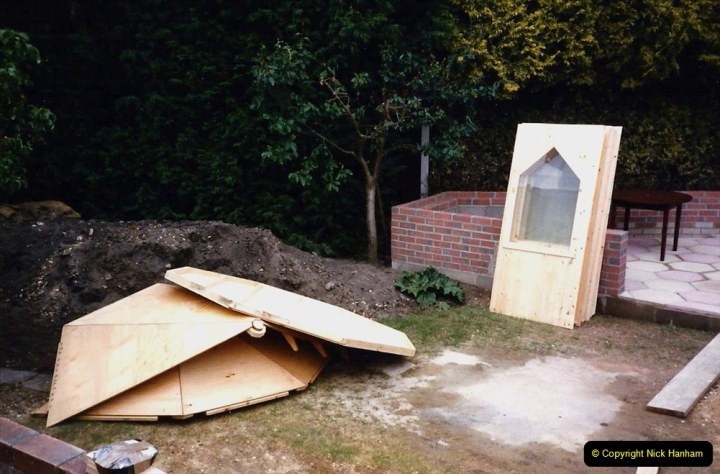 April 1990 Your Host alters the back garden. (32) Erecting Summer House. 32