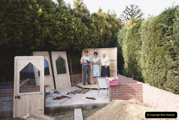 April 1990 Your Host alters the back garden. (34) Erecting Summer House. 32