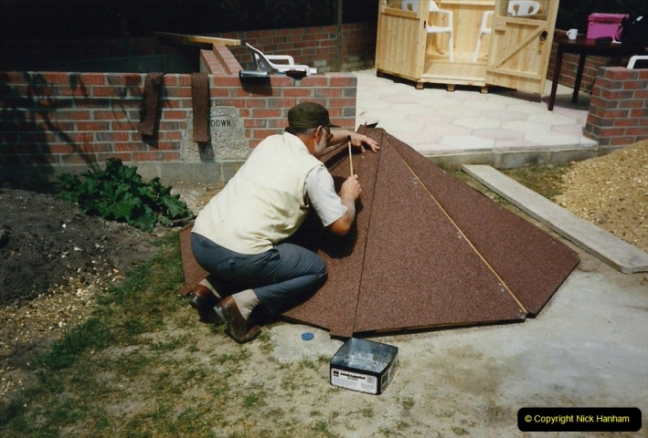 April 1990 Your Host alters the back garden. (36) Erecting Summer House. 32