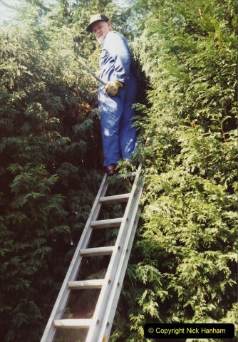 April 1990 Your Host alters the back garden. (63) Pruning trees with the help of my late Mother. 63