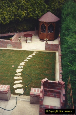 April 1990 Your Host alters the back garden. (65) The completed back garden. 65