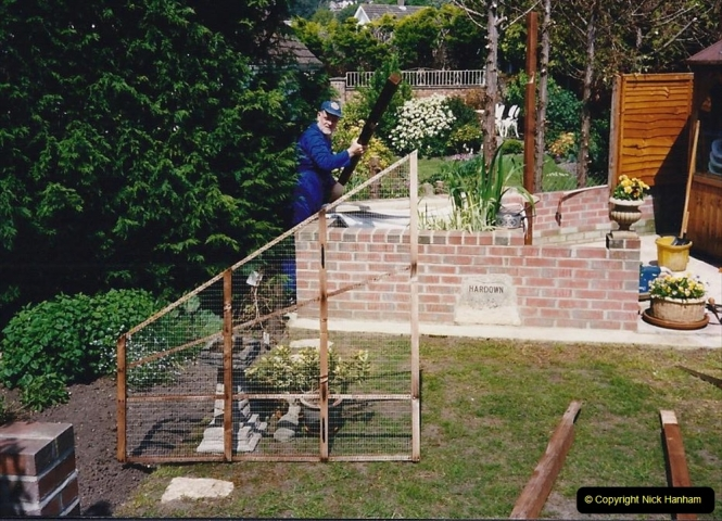 1993 Miscellaneous. (332) Your Host erecting a new fence with the help of a bob-a-job boy.0335